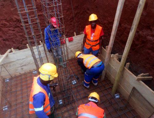 BTP à Ékié : Des dalles portées  par des migrants